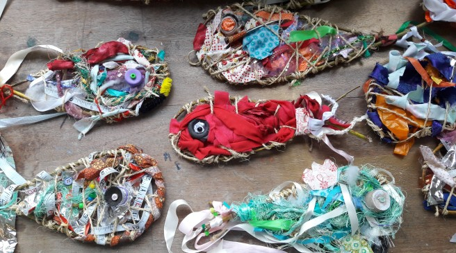 Weaving flotsam fish from recycled materials at Bedford Modern School